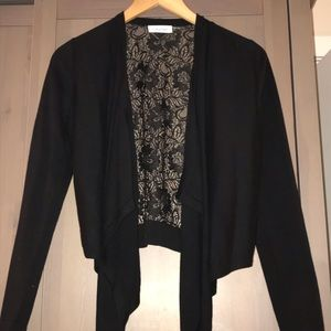 Calvin Klein black shrug with lace back.